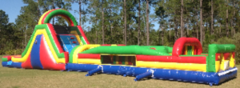 65-Foot rainbow inflatable obstacle course in Daytona Beach, FL